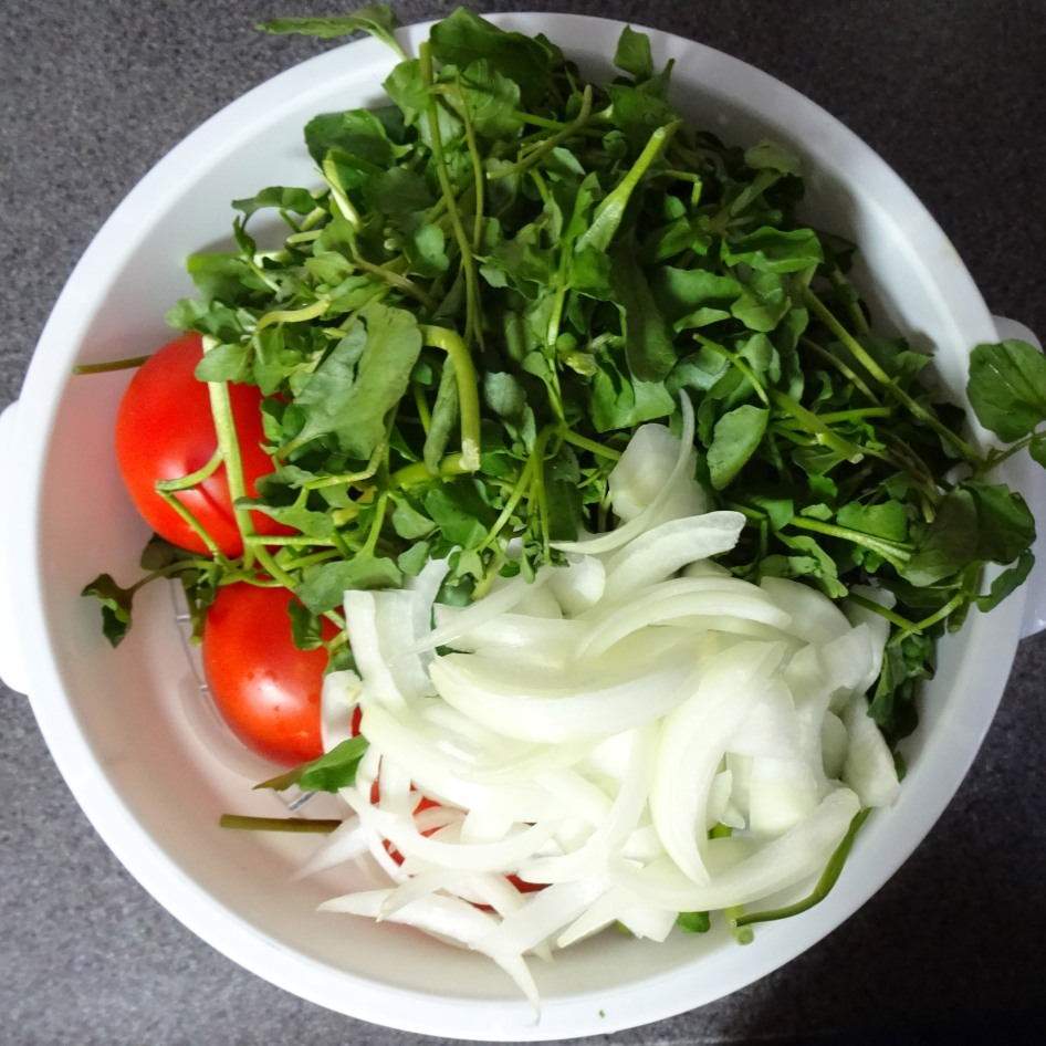 Tomatoes, onions, and watercress